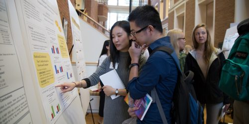 photograph of students viewing posters at 2016 Undergraduate Research Day