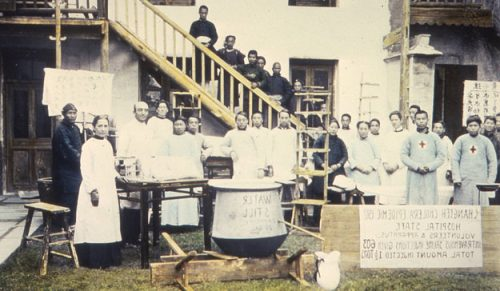 Hospital staff, volunteers, and apparatus during the Changteh cholera epidemic, Changde, Hunan, China, ca.1910-1919 (IMP-YDS-RG008-358-0008-0078)