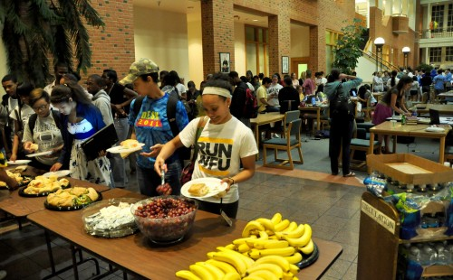 photograph of students lining up for the midnight snack table during Wake the Library in May, 2011.